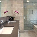 bathroom remodel with tile walls and tile flooring and grey quartzite vanity countertops