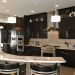 kitchen remodel with dark stained cabinetry and mosaic tile backsplash
