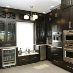 kitchen remodel with dark stained wooden cabinetry and quartz countertops