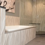 bathroom remodel with textured tile and granite built-in shelving