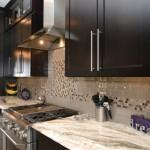 kitchen remodel with grey granite countertops and mosaic tile backsplash