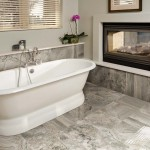 Gray floor tiles in bathroom with tub and fireplace