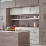 Light, modern kitchen with white and light wood cabinets and small island