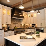White kitchen cabinets with dark countertops and opposite island - white countertop with dark cabinets and drawers