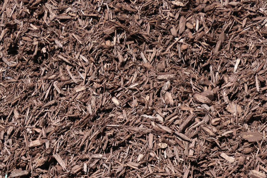 Mulch for garden and landscape beds rockford il for Dark brown landscape rock