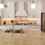 Stone countertops in kitchen with white cabinets
