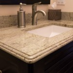 Bathroom sink and faucet options with variety of profiles of granite in bathroom