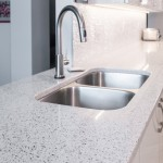 Stainless steel sink and faucet with granite countertops
