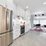 kitchen remodel with white cabinetry and grey luxury vinyl flooring