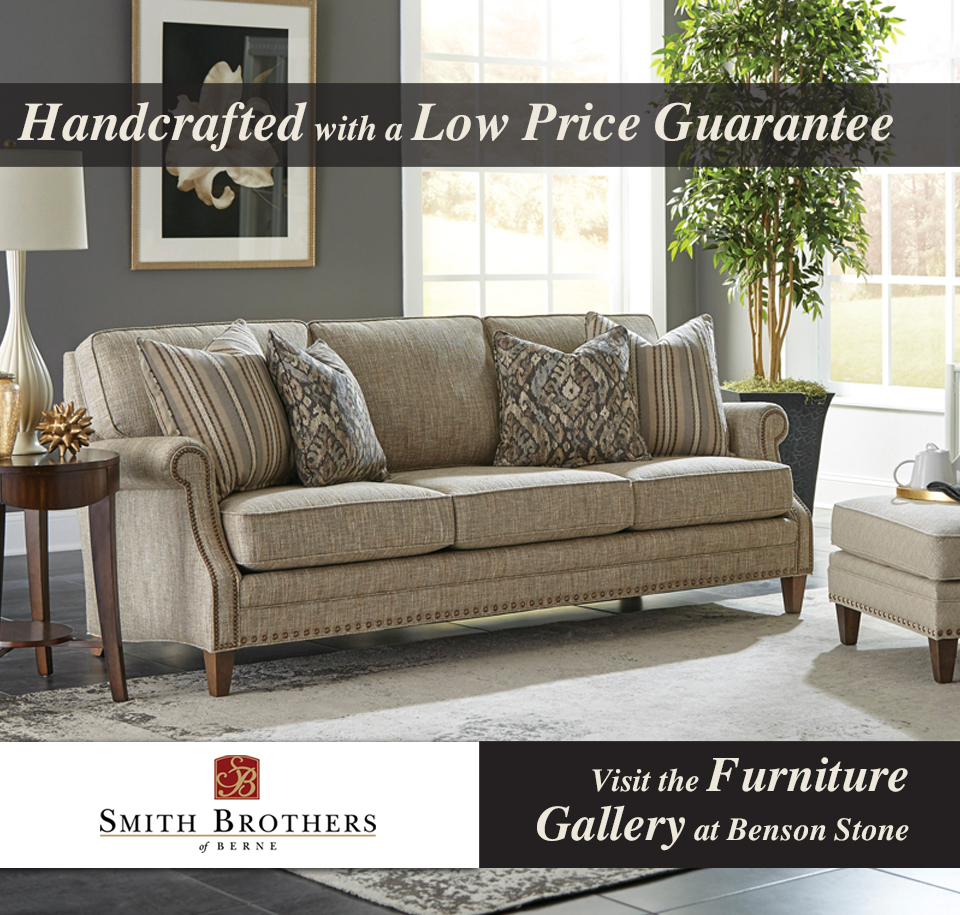 "Photo of a living room with Smith Brothers upholstered sofa and ottoman. The text reads ""Handcrafted with a low price guarantee"" and also ""Visit the furniture gallery at Benson Stone."""