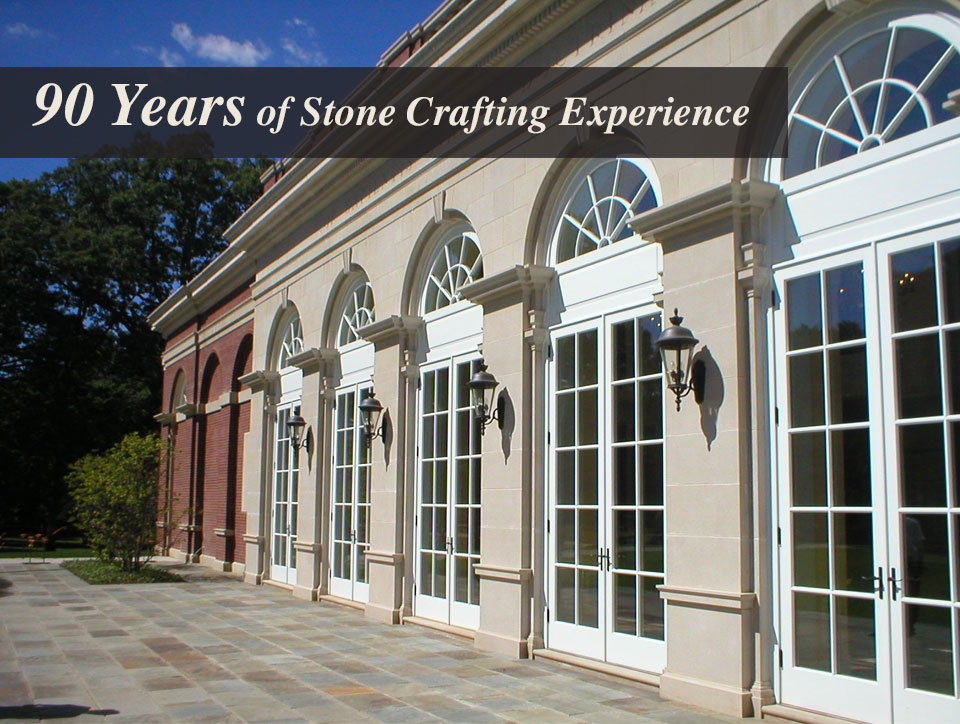 "This photo is of a building made of custom cut stone and says ""90 Years of Stone Crafting Experience"""