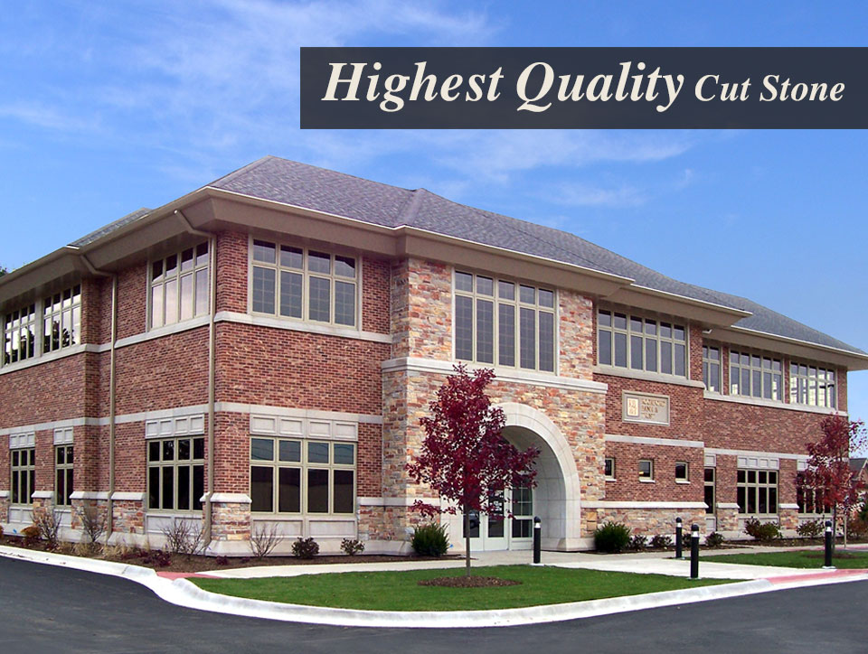 """This photo shows a brick, stone and custom cut stone building with text that reads """"highest quality cut stone"""""""