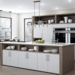 Sleek, modern kitchen with white and light wood cabinets