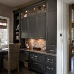 Dining room dark cabinets and bar