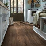 Luxury vinyl tile in dark brown wood, Sausalito Sunrise, look in mud room