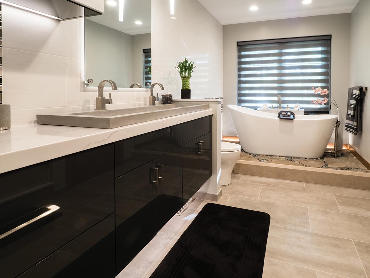 bathroom remodel with black contemporary vanity and quartz vanity countertops