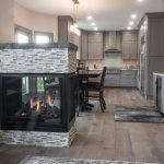 kitchen remodel with peninsula fireplace and grey cabinetry