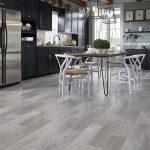 Grey luxury vinyl plank flooring in a kitchen