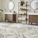 Luxury vinyl tile that looks like herringbone tile in kitchen with his and her sinks and mirros