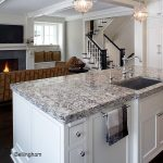 Bellingham quartz countertops on island with sink and open to living room