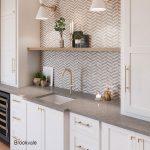 Brookvale quartz countertops against the white cabinets and herringbone backsplash are a beautiful combination