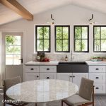 Open kitchen with farmhouse single, wood beams and chatsworth quartz countertops