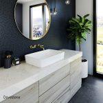 The dark walls and bright white sink compliment the Dovestone quartz countertops in this bathroom