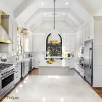 Large white kitchen with Torquay quartz countertops and top of the line appliances