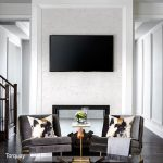 Torquay quartz wall for TV mount in living room with chairs and side table.