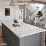 Trafalgar quartz island with gray drawers in open concept kitchen to living room