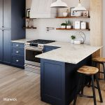Warwick quartz countertops and open wood shelving are a lovely contrast to the navy cabinets