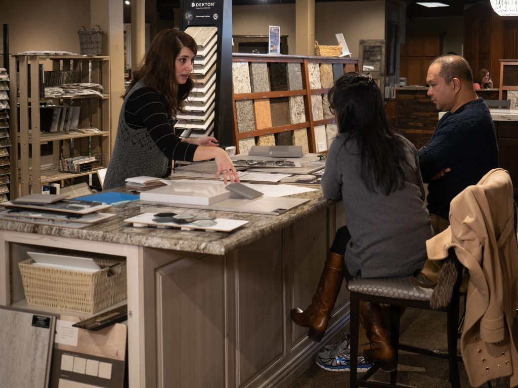 Kitchen and Bath Designers help pick out countertops and other items with customers