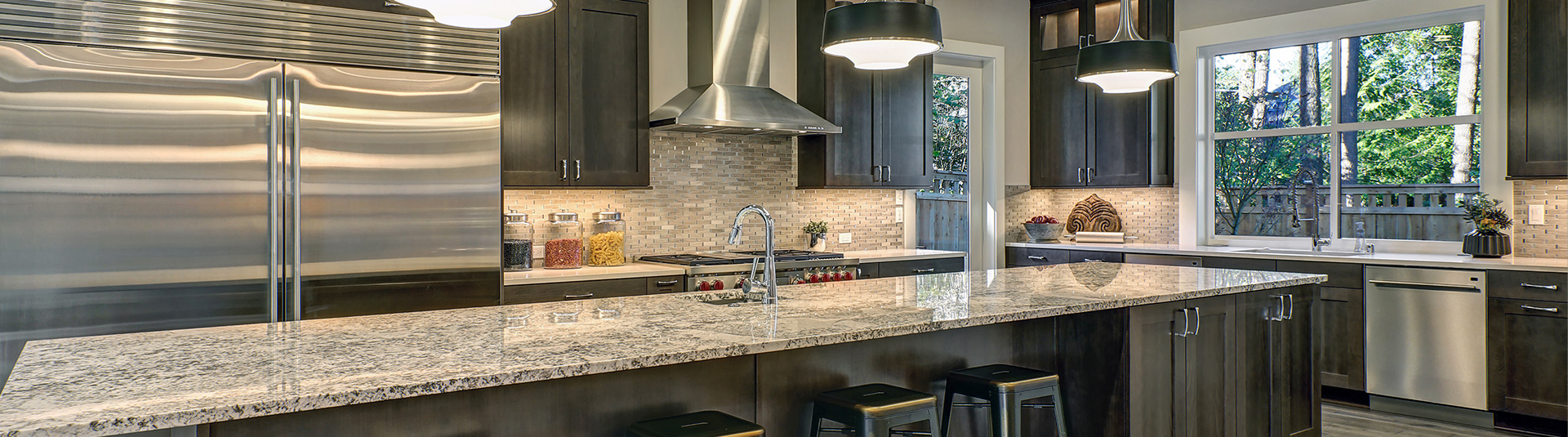 Stone countertops in kitchen with stainless steel appliances