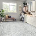 Patterned white and grey ceramic floor tile in a bathroom