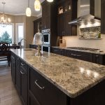 brown and gold granite countertops on a kitchen island and surround