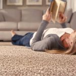 Textured beige luxury carpet flooring in a living room