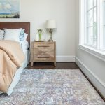 soft grey and white patterned area rug in bedroom