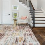 abstract warm tone soft area rug in entryway