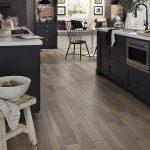 Soft beige hardwood floors in a dining room