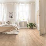 Light oak hardwood floors in a bedroom