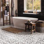 Black and white ornate ceramic floor tile in a bathroom