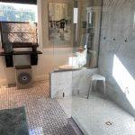 basketweave floor tile and glass walk-in shower