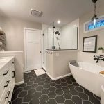 bath remodel with charcoal grey hexagon floor tile and a white porcelain freestanding tub