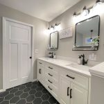 white vanity cabinets and quartz countertops