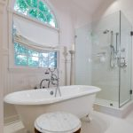 bathroom remodel with white tile, clawfoot tub and glass walk-in shower