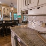 traditional kitchen remodel with grey granite countertop and mosaic tile backsplash