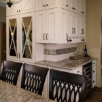 traditional kitchen remodel with white custom cabinetry with mirrored glass inlays and mosaic tile backsplash