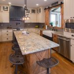 farmhouse kitchen design with hardwood flooring and rustic iron counter stools