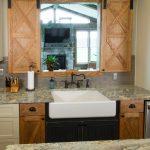 kitchen design with barndoor window above the farmhouse sink
