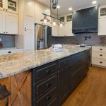 farmhouse kitchen design with granite countertops black painted island cabinetry